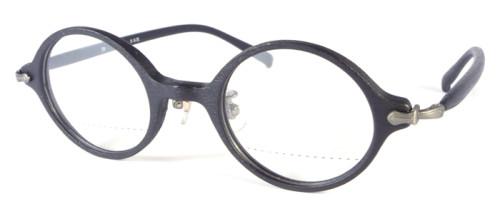 黒の木のような風合いの丸メガネ