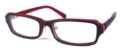 表が黒、裏が赤色、木のような風合いのメガネ