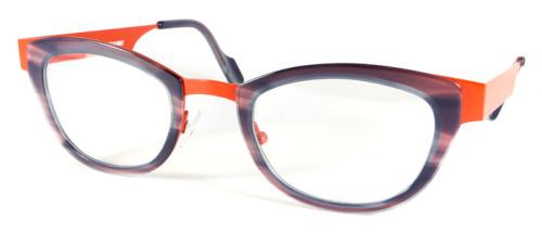 オレンジとグレーの異素材を組み合わせたメガネ