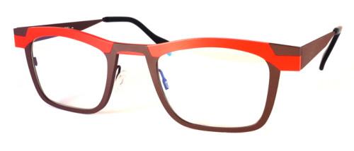 オレンジとブラウンのチタン素材のメガネ
