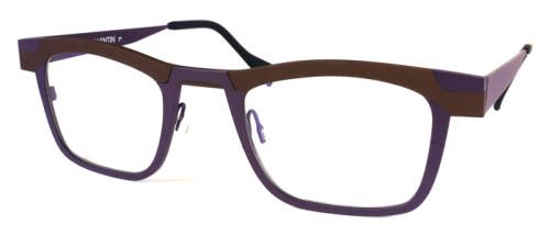 ブラウンとパープルのチタン素材のメガネ